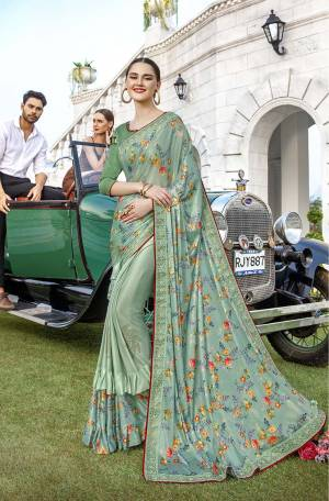 Get Ready For The Upcoming Festive And Wedding Season With This Very Beautiful Designer Saree In Pastel Green Color Paired With Green Colored Blouse. This Saree IS Lycra Based Beautified With Prints And Stone Work Paired With Art Silk Fabricated Blouse. Buy Now.