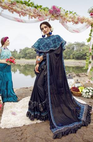 Grab This Very Beautiful Trendy Saree In Navy Blue Color. This Saree Is Fabricated On Lycra Paired With Art Silk Blouse And Net Fabricated Heavy Embroidered Cape. Its Fabric Is Light Weight And Ensures Superb Comfort Throughout The Gala.