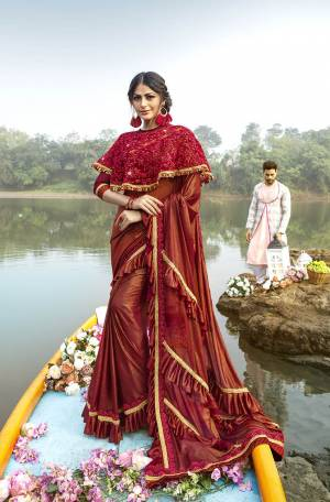For A Royal Look, Grab This Designer Fancy Saree With Cape In Red Color. This Pretty Saree Is Fabricated On Lycra Paired With Art Silk Fabricated Blouse And Embroidered Net Fabricated Cape. Its Trendy Pattern And Design Will Earn You Lots Of Compliments From Onlookers.
