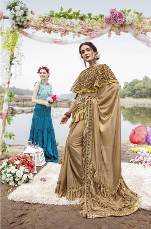 Grab This Very Beautiful Trendy Saree In Beige And Brown Color. This Saree Is Fabricated On Lycra Paired With Art Silk Blouse And Net Fabricated Heavy Embroidered Cape. Its Fabric Is Light Weight And Ensures Superb Comfort Throughout The Gala.
