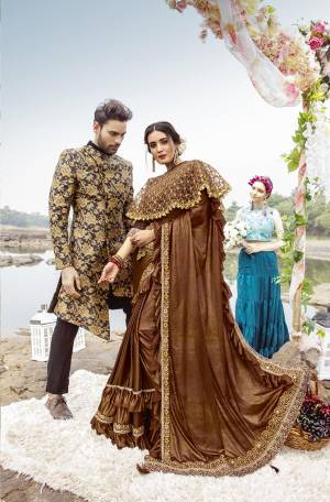 For A Royal Look, Grab This Designer Fancy Saree With Cape In Brown Color. This Pretty Saree Is Fabricated On Lycra Paired With Art Silk Fabricated Blouse And Embroidered Net Fabricated Cape. Its Trendy Pattern And Design Will Earn You Lots Of Compliments From Onlookers.