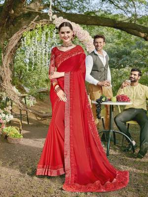 Adorn The Pretty Angelic Look Wearing This Designer Saree In Red Color Paired With Red Colored Blouse. This Saree Is Georgette Based Paired With Art Silk And Net Fabricated Blouse. It Is Beautified With Heavy Embroidered Blouse And Saree Lace Border.