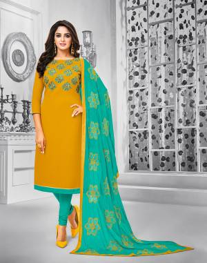 Celebrate This Festive Season With Beauty And Comfort Wearing This Suit In Musturd Yellow Colored Top Paired With Contrasting Sea Green Colored Bottom And Dupatta. This Dress Material Is Cotton Based Paired With Chiffon Fabricated Dupatta. Its Top And Dupatta are Beautified With Resham Embroidery.