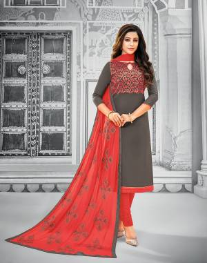 If Those Readymade Suit Does Not Lend You The Desired Comfort Than Grab This Cotton Based Embroidered Dress Material In Dark Grey Colored Top Paired With Contrasting Red Colored Bottom And Dupatta. Its Pretty Chiffon Dupatta Is Beautified With Resham Embroidery. Get This Stitched As Per Your Desired Fit And Comfort.