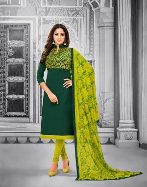 Add This Pretty Dress Material To Your Wardrobe In Pine Green Colored Top Paired With Pear Green Colored Bottom And Dupatta. This Dress Material Is Cotton Based Paired With Chiffon Fabricated Dupatta. Its Top and Dupatta are Beautified With Attractive Resham Embroidery.