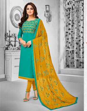 Celebrate This Festive Season With Beauty And Comfort Wearing This Suit In Sea Green Colored Top Paired With Contrasting Musturd Yellow Colored Bottom And Dupatta. This Dress Material Is Cotton Based Paired With Chiffon Fabricated Dupatta. Its Top And Dupatta are Beautified With Resham Embroidery.