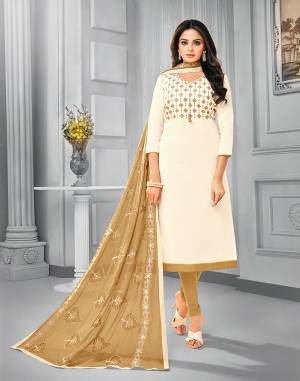 Add This Pretty Dress Material To Your Wardrobe In Off-White Colored Top Paired With Beige Colored Bottom And Dupatta. This Dress Material Is Cotton Based Paired With Chiffon Fabricated Dupatta. Its Top and Dupatta are Beautified With Attractive Resham Embroidery.