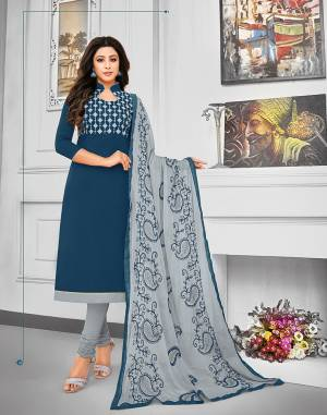 Celebrate This Festive Season With Beauty And Comfort Wearing This Suit In Navy Blue Colored Top Paired With Contrasting Grey Colored Bottom And Dupatta. This Dress Material Is Cotton Based Paired With Chiffon Fabricated Dupatta. Its Top And Dupatta are Beautified With Resham Embroidery.