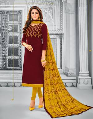 If Those Readymade Suit Does Not Lend You The Desired Comfort Than Grab This Cotton Based Embroidered Dress Material In Maroon Colored Top Paired With Contrasting Musturd Yellow Colored Bottom And Dupatta. Its Pretty Chiffon Dupatta Is Beautified With Resham Embroidery. Get This Stitched As Per Your Desired Fit And Comfort.