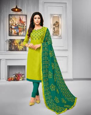 Add This Pretty Dress Material To Your Wardrobe In Parrot Green Colored Top Paired With Teal Green Colored Bottom And Dupatta. This Dress Material Is Cotton Based Paired With Chiffon Fabricated Dupatta. Its Top and Dupatta are Beautified With Attractive Resham Embroidery.