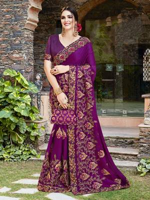 Get Ready For The Upcoming Wedding And Festive Season With This Designer Saree In Purple Color Paired With Purple Colored Blouse. This Heavy Embroidered Saree Is Satin Georgette Based Paired With Art Silk Fabricated Blouse.