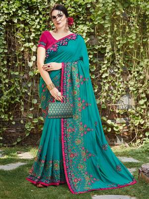 Get Ready For The Upcoming Wedding And Festive Season With This Designer Saree In Turquoise Blue Color Paired With Contrasting Dark Pink Colored Blouse. This Heavy Embroidered Saree Is Satin Silk Based Paired With Art Silk Fabricated Blouse.
