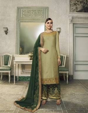 Here Is A Very Beautiful Designer Suit In Light Green Colored Top Paired With Dark Green Colored Bottom And Dupatta. This Semi-Stitched Suit Can Be Made As Lehenga Suit Or Plazzo Suit, Either Way You Like. Its Top Is Fabricated On Satin Silk Beautified With Detailed Embroidery Paired With Jacquard Silk Fabricated Bottom And Georgette Fabricated Stone Work Dupatta.