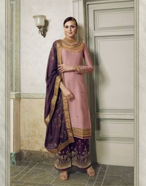 Get Ready For This Wedding And Festive Season With This Beautiful Designer Lehenga Or Plazzo Suit, You Can Get This Stitched In Either Of The Ways. This Pretty Suit Is In Pink Colored Top Paired With Contrasting Purple Colored Bottom And Dupatta. Its Top Is Fabricated On Satin Silk Paired With Jacquard Silk Bottom And Georgette Fabricated Stone Work Dupatta. Buy This Lovely Piece Now.