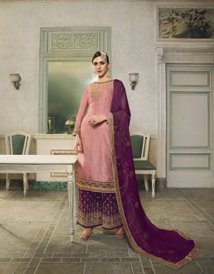 Get Ready For This Wedding And Festive Season With This Beautiful Designer Lehenga Or Plazzo Suit, You Can Get This Stitched In Either Of The Ways. This Pretty Suit Is In Pink Colored Top Paired With Magenta Pink Colored Bottom And Dupatta. Its Top Is Fabricated On Satin Silk Paired With Jacquard Silk Bottom And Georgette Fabricated Stone Work Dupatta. Buy This Lovely Piece Now.