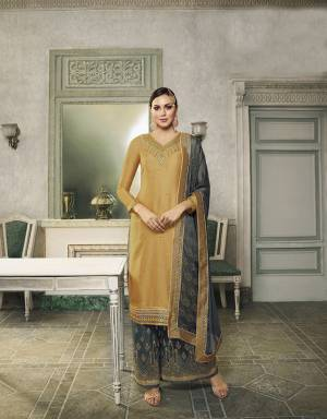 Here Is A Very Beautiful Designer Suit In Musturd Yellow Colored Top Paired With Grey Colored Bottom And Dupatta. This Semi-Stitched Suit Can Be Made As Lehenga Suit Or Plazzo Suit, Either Way You Like. Its Top Is Fabricated On Satin Silk Beautified With Detailed Embroidery Paired With Jacquard Silk Fabricated Bottom And Georgette Fabricated Stone Work Dupatta.