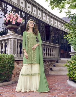 Grab This Beautiful Designer Sharara Suit In Light Green Colored Top Paired With Off-White Colored Sharara And Light Green colored Dupatta. Its Top IS Fabricated On Satin Silk With Embroidered Net Inner. Its Sharara IS Fabricated On Georgette Paired With Chiffon Dupatta.