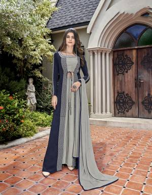 Rich And Elegant Looking Designer Indo-Western Dress Is Here In Grey And Navy Blue Color. Its Blouse, Bottom And Jacket Are Fabricated On Crepe Paired With Chiffon Fabricated Dupatta.