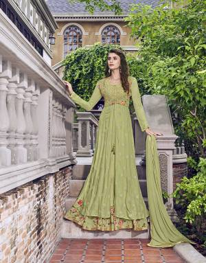 Get Ready For The Upcoming Wedding And Festive Season With This Designer Semi-Stitched Suit In Light Green Color. Its Top And Jacket Are Fabricated on Muslin Paired With Chiffon Fabricated Dupatta. It Is Beautified With Digital Prints And Detailed Embroidery.
