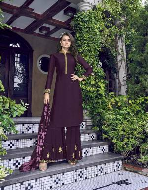 Catch All The Limelight At The Next Function You Attend Wearing This Designer Sharara Suit In All Over Wine Color. Its Top IS Silk Based paired With Georgette Bottom and Digital Printed Scarf.
