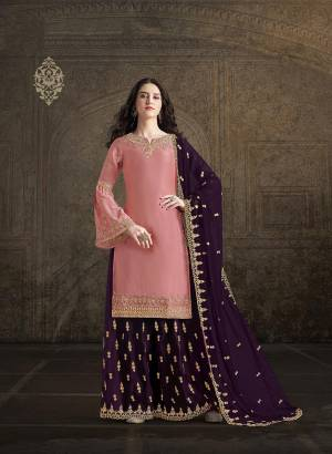 Get Ready For This Wedding And Festive Season With This Heavy Designer Suit In Pink Colored Top Paired With Purple Colored Bottom And Dupatta. Its Top And Bottom Are Fabricated On Satin Paired With georgette Fabricated Dupatta. Its Pretty Top, Bottom And Dupatta Are Beautified With Detailed Heavy Embroidery.