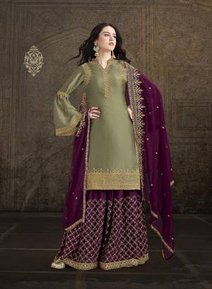 Flaunt Your Rich and Elegant Taste Wearing This Heavy Designer Suit In Olive Green Color Paired With Wine Colored Bottom And Dupatta. This Beautiful Heavy Embroidered Suit Is Fabricated on Satin Paired With Georgette Fabricated Dupatta.