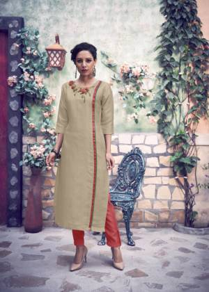 Here Is A Readymade Pair Of Kurti With Bottom In Light Beige And Red Color Respectively. This Kurti IS Fabricated On Satin Silk Paired With Silk Blend Bottom. It Is Beautified With Hand Work. Buy Now.