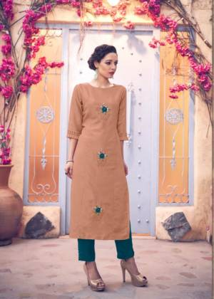 New And Unique Shade Is Here To Add Into Your Wardrobe With This Designer Readymade Kurti In Dusty Peach Color Paired With Contrasting Teal Blue Colored Bottom. This Pretty Pair Is Silk Based Beautified With Hand Work Butti.