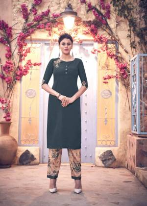 Add This Designer Readymade Kurti In Dark Grey Color Paired With beige Colored Digital Printed bottom. This Kurti IS Fabricated on Satin Silk Beautified With Hand Work.
