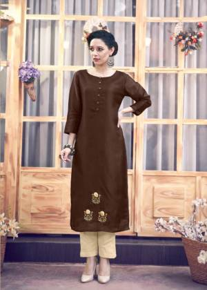 You Will Definitely Earn Lots Of Compliments Wearing This Designer Readymade Kurti In Dark Brown Color Paired With Cream Colored Bottom. The Kurti Is Satin Silk Paied With Silk Blend Bottom. Buy This Kurti Now.