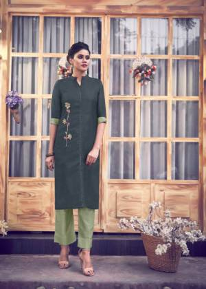 Here Is A Readymade Pair Of Kurti With Bottom In Dark Grey And Pastel Green Color Respectively. This Kurti IS Fabricated On Satin Silk Paired With Silk Blend Bottom. It Is Beautified With Hand Work. Buy Now.