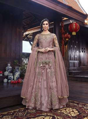Look Pretty In This Designer Indo Western Dress In All Over Onion Pink Color. Its Gown IS Fabricated On Satin Paired With Embroidered Net Fabricated Jacket With Santoon Bottom And Net Dupatta.
