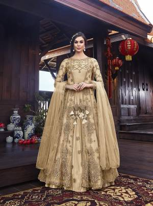 Look Pretty In This Designer Indo Western Dress In All Over Cream Color. Its Gown IS Fabricated On Satin Paired With Embroidered Net Fabricated Jacket With Santoon Bottom And Net Dupatta.