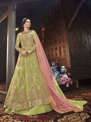 Get Ready Fot The Upcoming Festive And Wedding Season With This Designer Indo Western Suit With Two Bottom,In Teal Green Color Paired With Teal green Colored Dupatta. Its Heavy Embroidered Top Is Fabricated On Net Paired With Art Silk Lehenga And Net Dupatta. Also It Comes With A Very Pretty Embroiderd Art Silk Fabricated Pant.