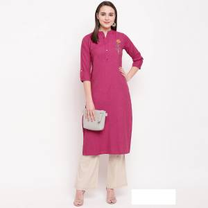Add This Pretty And Elegant Looking Readymade Straight Kurti In Dark Pink Color Fabricated On Rayon. It Is Beautified With Hand Work. It Is Light Weight And Easy To Carry All Day Long.