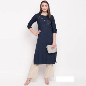 Enhance Your Personality Wearing This Designer Readymade Straight Kurti In Navy Blue Color Fabricated On Rayon. It Has Very Pretty Elegant Hand Work Over The Yoke.