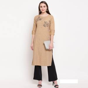 Flaunt Your Rich And Elegant Taste Wearing This Designer Readymade Straight Kurti In Beige. This Kurti Is Rayon Based Beautified With Hand Work. Buy Now.