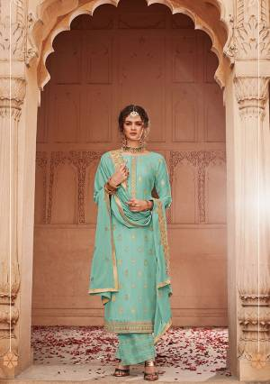 Add This Very Pretty Semi-Stitched Suit To Your Wardrobe In Tuquoise Blue Color. This Heavy Designer Suit Is Fabricated On Jacquard Silk Paired With Santoon Bottom And Chinon Fabricated Dupatta. Its Top and Dupatta are Beautified With Heavy Embroidery Giving You An Attractive Look.