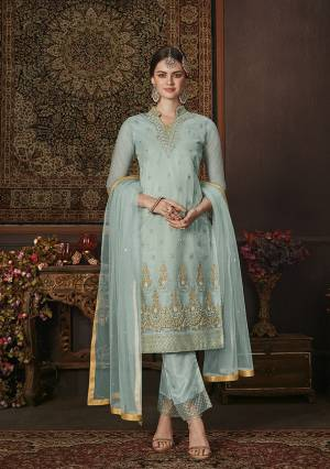 Grab This Beautiful Shade In Blue With This Designer Straight Suit In Aqua Blue Color. Its Pretty Embroidered Top and Dupatta Are Net Based Paired With Soft Silk Fabricated Bottom. It Is Beautified With Attractive Jari And Resham Embroidery With Stone Work.