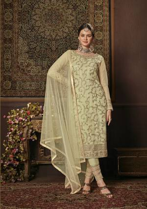 This Season Is About Subtle Shades And Pastel Play, So Grab This Heavy Designer Straight Suit In Pastel Green Color. Its Top Is Net Based Paired With Soft Silk Bottom And Net Fabricated Dupatta. It Top Is Beautified With Attractive All Over Embroidery.