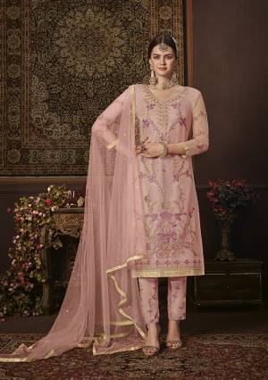 Look Pretty In This Beautiful Designer Straight Suit In Baby Pink Color. Its Top Is Fabricated On Net Paired With Soft Silk Bottom and Net Fabricated Dupatta. It Is Beautified With Attractive Embroidery.
