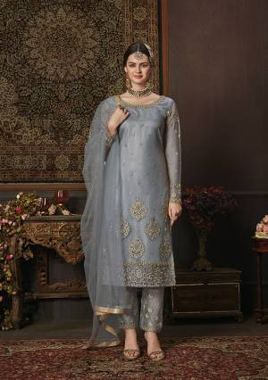 Add This New Shade To Your Wardrobe With This Heavy Designer Straight Suit In Steel Blue Color. Its Embroidred Top And Dupatta Are Net Based Paired With Soft Silk Bottom. Buy Now.