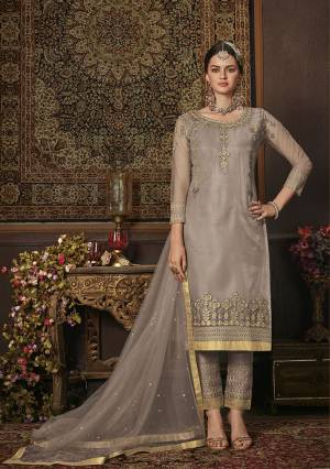 This Season Is About Subtle Shades And Pastel Play, So Grab This Heavy Designer Straight Suit In Light Grey Color. Its Top Is Net Based Paired With Soft Silk Bottom And Net Fabricated Dupatta. It Top Is Beautified With Attractive All Over Embroidery.