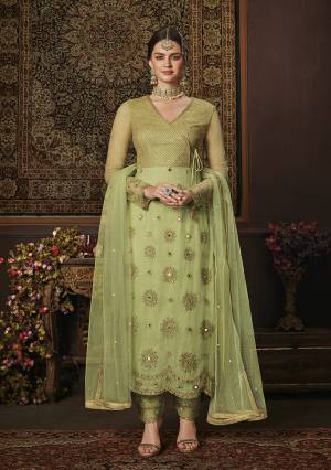 Add This Pretty Shade To Your Wardrobe With This Heavy Designer Straight Suit In Light Green Color. Its Embroidred Top And Dupatta Are Net Based Paired With Soft Silk Bottom. Buy Now.