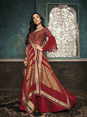 Adorn The Pretty Angelic Look Wearing This Designer Floor Length Suit In Red Color. Its Top Is Fabricated On Art Silk With Attractuve Embroidred Yoke And Bell Sleeve Paired With Santoon Bottom And Fancy Georgette Dupatta.