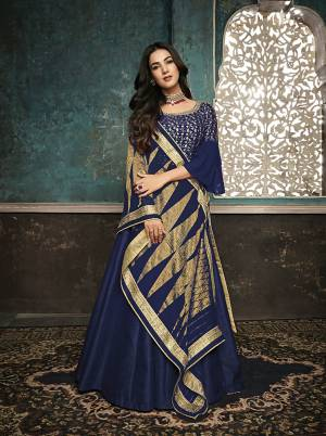 Adorn The Pretty Angelic Look Wearing This Designer Floor Length Suit In Royal Blue Color. Its Top Is Fabricated On Art Silk With Attractuve Embroidred Yoke And Bell Sleeve Paired With Santoon Bottom And Fancy Georgette Dupatta.