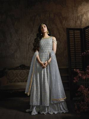 New Shade Is Here To Add Into Your Wardrobe With This Heavy Designer Suit In Steel Blue Color. Its Heavy Tone To Tone Embroidered Top Is Fabricated On Georgette Paired With Chiffon Bottom And Net Fabricated Dupatta. This Pretty Indo-Western Suit Pattern And Its Color Will Definitely Earn You Lots Of Compliments From Onlookers.