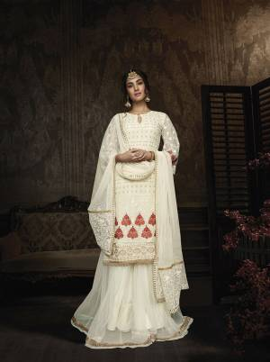 Flaunt Your Rich And Elegant Taste Wearing This Designer Suit In Off-White Color. Its Heavy Embroidered Top Is Fabricated On Georgette Paired With Net Fabricated Bottom And Dupatta. Buy This Lovely Suit Now.