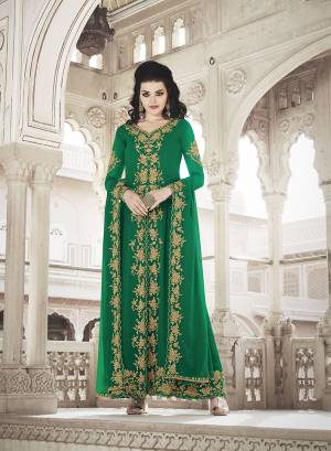 Celebrate This Festive And Wedding Season Wearing This Heavy Designer Suit In Green Color. Its Embroidered Top And Dupatta are Fabricated On Georgette Paired With Soft Silk Fabricated Embroidred Bottom.