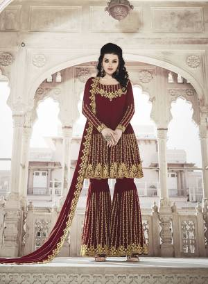 Grab This Very Beautiful And Attractive Looking Heavy Designer Sharara Suit In Maroon Color. Its Top And Dupatta Are Fabricated on Georgette Paired With Soft Silk Bottom. Its Top, Bottom And Dupatta Are Beautified With Heavy Jari And Stone Work.